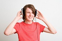 Teenage boy listening to music