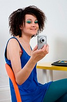 Teenage girl using digital camera