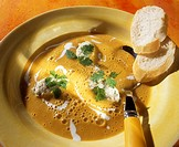 Orange and carrot soup with veal dumplings