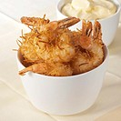 Shrimps fried in coconut batter with lemon mayonnaise