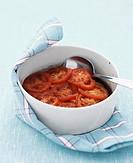 Courgette, smoked pork and tomato bake