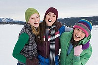 Laughing friends in winter attire