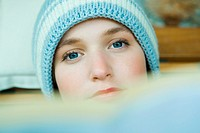 Teenage girl wearing knit hat, looking at camera, head