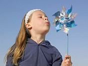 Girl 4-6 Blowing on Toy Windmill, Close-up