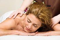 Mature woman having back massage, close-up