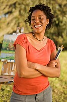 Smiling female painter in field, portrait, El Cerrito, California, USA