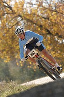 Mountain biker racing on a trail