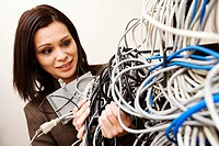 Businesswoman with cables in server room