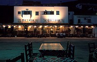 Ostria Restaurant-Grill, Merichas, at night, tables  Kythnos, Cyclades, Greece