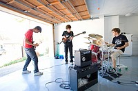 Three teenage boys 16-18 in garage band