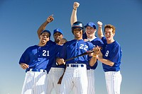 Baseball team, in blue uniforms, celebrating victory post match, arms up, smiling, front view (thumbnail)
