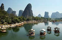 China, Guangxi Province, Guilin, Yangshuo, Yulong River, bamboo rafts on river
