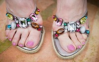Woman wearing bejeweled sandals