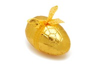 Easter Egg in gold foil with yellow ribbon on white background