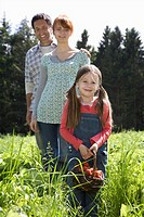Parents and daughter 5_6 in strawberry field portrait