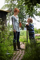 Mother and son 5_6 with spade in countryside
