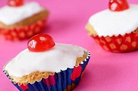 Fairy cakes with glace cherries