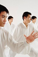 Young men practicing Tai Chi