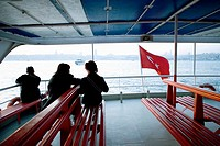People on a ferry boat waiting for departure. Bosphore, Istanbul, Turkey