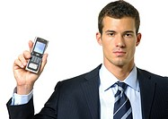 Portrait of a businessman showing a mobile phone