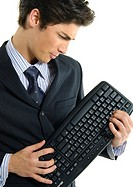 Businessman holding a computer keyboard