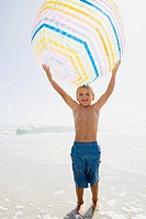 Boy holding a giant beachball (thumbnail)
