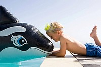 Boy with inflatable whale