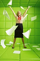 Woman in green padded cell throwing papers
