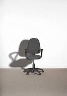 Office chair against a wall