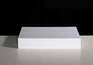 A pile of white paper sitting on a table