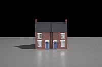 Model of a terraced brick house sitting on a table