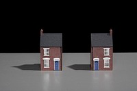Model of a terraced brick house split into two