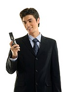 Businessman text messaging with a mobile phone and smiling (thumbnail)