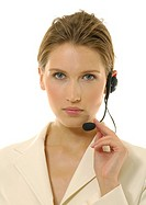 Portrait of a businesswoman wearing a headset (thumbnail)