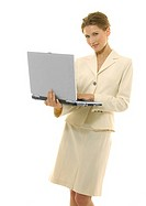 Portrait of a businesswoman working on a laptop and grinning
