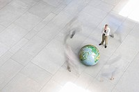 Businessman looking at globe