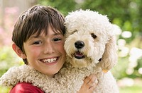 Young boy smiling with dog