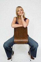 Young woman sitting in chair
