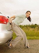 Woman Pushing Car From Rear