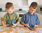 Two young boys with play money