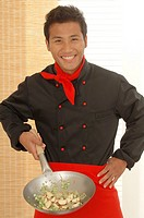 Asian cook with a peking pan