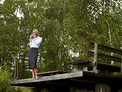 Businesswoman standing on deck
