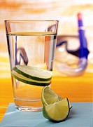 Glass of water with slices of lime