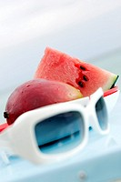 Plate with watermelon, mango and sunglasses