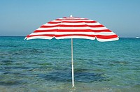 Red and white sunshade in the water