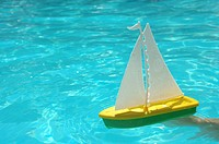 Toy boat in the water