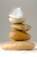 A stack of stones and a feather