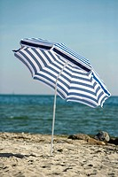 Blue and white sunshade on the beach