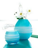 Japanese anemone in light blue glass vases