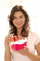 Woman with perfume in a gift box